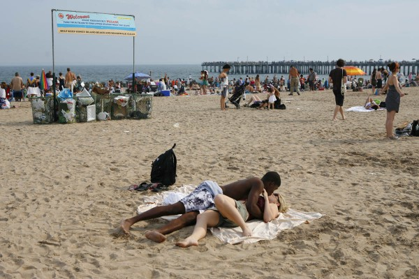 Interracial love on Coney Island Beach